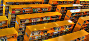 Photograph of Orange shelves in a library.